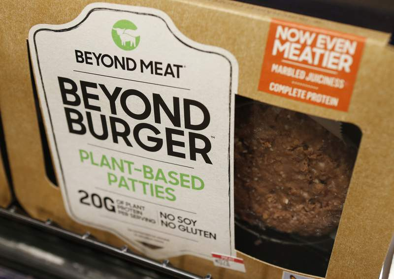 FILE - In this June 27, 2019, file photo, a meatless burger patty called Beyond Burger by Beyond Meat is displayed at a grocery store in Richmond, Va. Plant-based meat company Beyond Meat has posted a first-quarter loss after higher sales were offset by marketing costs and lower prices. The company based in El Segundo, California reported Thursday, May 6, 2021 that its revenue rose 11% to $108.2 million in the January-March period. (AP Photo/Steve Helber, File)