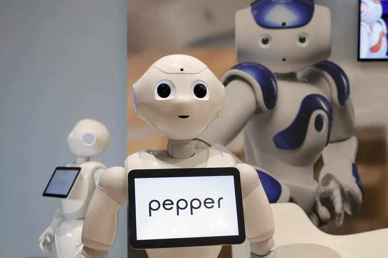 FILE - In this May 25, 2016, file photo, Pepper, the robot of Softbank Robotics Europe, performs during the Innorobo European summit, an event dedicated to the service robotics industry in Aubervilliers, outskirts of Paris. Japanese technology company SoftBank denies its pulling the plug on its friendly talking bubble-headed Pepper robot. There is absolutely no change to our Pepper business, SoftBank Robotics Corp. spokesperson said Wednesday, June 30, 2021.(AP Photo/Francois Mori, File)