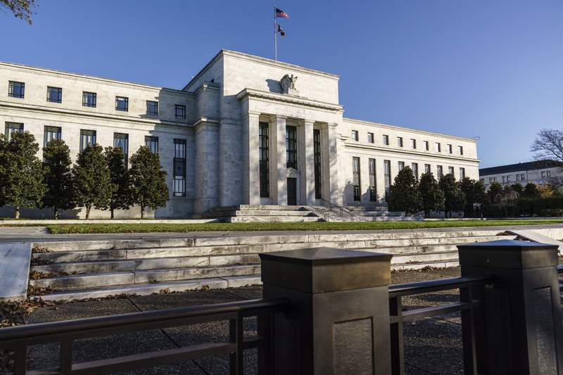 """FILE - This Monday, Nov. 16, 2020 file photo shows the Federal Reserve in Washington. Federal Reserve officials last month supported providing advance notice before the central bank makes changes to its $120 billion in monthly bond purchases. The minutes of those discussions released Wednesday, Jan. 6, 2021 show wide support for adding language to the Fed's policy statement to indicate that the purchases would continue until substantial further progress"""" has been made toward the central bank's maximum employment and price stability goals. (AP Photo/J. Scott Applewhite, File)"""