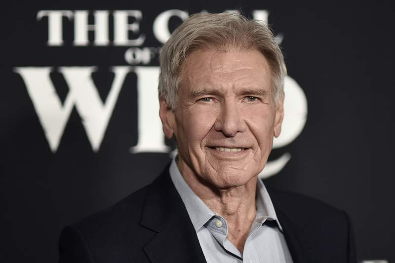 """FILE - In this Feb. 13, 2020 file photo, Harrison Ford attends the premiere of """"The Call of the Wild"""" in Los Angeles. Ford was piloting a plane that wrongly crossed a runway where another plane was landing, and federal authorities are investigating, officials and a representative for the actor said Wednesday. (Photo by Richard Shotwell/Invision/AP)"""