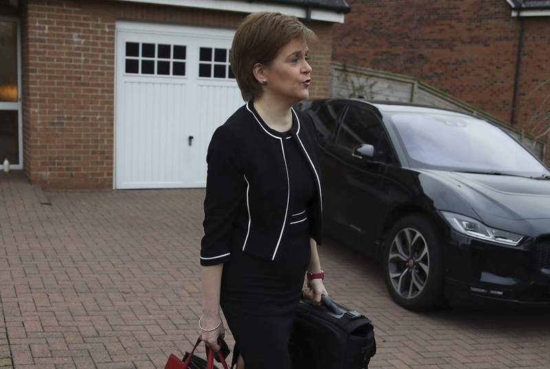 """Scotland's First Minister Nicola Sturgeon, leaves her home, in Glasgow, Scotland, Tuesday, March 23, 2021. A Scottish parliamentary investigation says Sturgeon misled lawmakers about sexual harassment allegations against her predecessor. Lawmakers have been investigating the Scottish governments handling of sexual harassment allegations against former First Minister Alex Salmond. A report published Tuesday says Sturgeon gave lawmakers an inaccurate account of what happened at a key meeting with Salmond in 2018 and """"misled the committee on this matter. (Andrew Milligan/PA via AP)"""