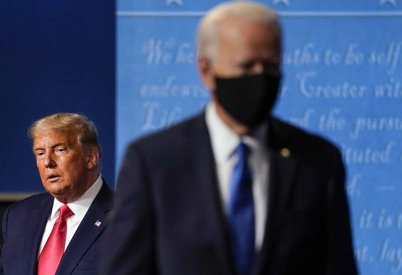FILE - President Donald Trump, left, remains on stage as then-Democratic presidential candidate former Vice President Joe Biden, right, walks away Thursday, Oct. 22, 2020, at Belmont University in Nashville, Tenn. President Trump's extraordinary effort to overturn Joe Biden's win in Wisconsin returns to the courtroom on Friday, Dec. 11, 2020 with hearings in federal and state lawsuits seeking to invalidate hundreds of thousands of ballots and give the GOP-controlled Legislature the power to name Trump the winner. (AP Photo/Julio Cortez, file)