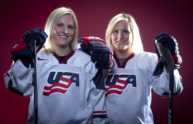FILE - In this Oct. 2, 2013, file photo, United States Olympic Winter Games hockey players Jocelyne Lamoureux, left, and Monique Lamoureux pose for a portrait at the Team USA Media Summit in Park City, Utah. USA Hockeys twin-sister Lamoureux tandem is retiring after 14 years of international competition. Jocelyne Lamoureux-Davidson and Monique Lamoureux-Morando made the joint announcement in an article published on The Players Tribune on Tuesday, Feb. 9, 2021.  (AP Photo/Carlo Allegri, File)