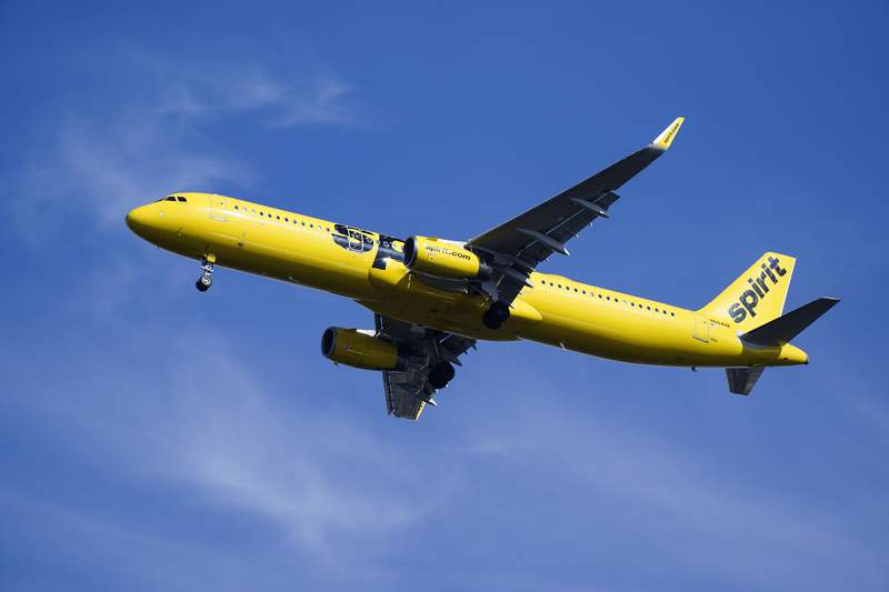 A Spirit Airlines jet approaches Philadelphia International Airport in Philadelphia, Wednesday, Feb. 24, 2021. On Monday, Aug. 16, 2021, Spirit said the cancellation of more than 2,800 flights over an 11-day stretch this summer cost the budget airline about $50 million in lost revenue and caused spending to soar. (AP Photo/Matt Rourke)
