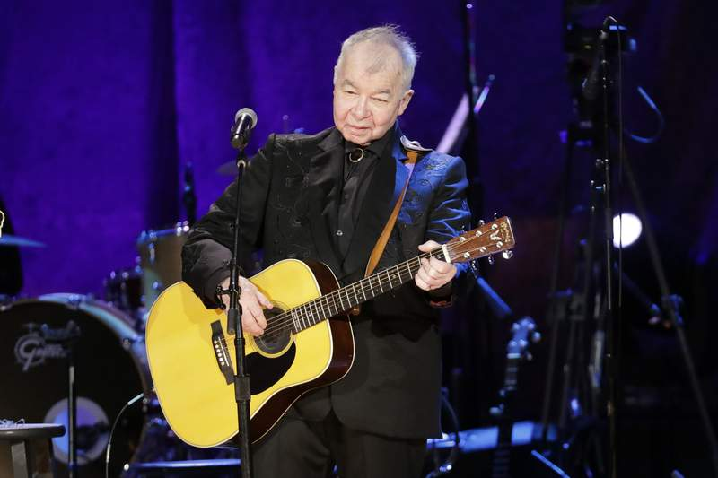 FILE  In this Sept. 11, 2019, file photo, John Prine performs at the Americana Honors & Awards show in Nashville, Tenn. Prine was named artist of the year at the Americana Honors and Awards. The Americana Music Association announced the winners online this year after their awards show, normally held in Nashville, Tennessee, was cancelled because of the pandemic. Prine died April 7, 2020, from complications of the coronavirus. He was 73. (AP Photo/Wade Payne, File)
