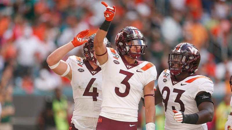 Caleb Farley #3 of the Virginia Tech Hokies celebrates with teammates against the Miami Hurricanes during the first half at Hard Rock Stadium on October 05, 2019 in Miami, Florida. (Photo by Michael Reaves/Getty Images)