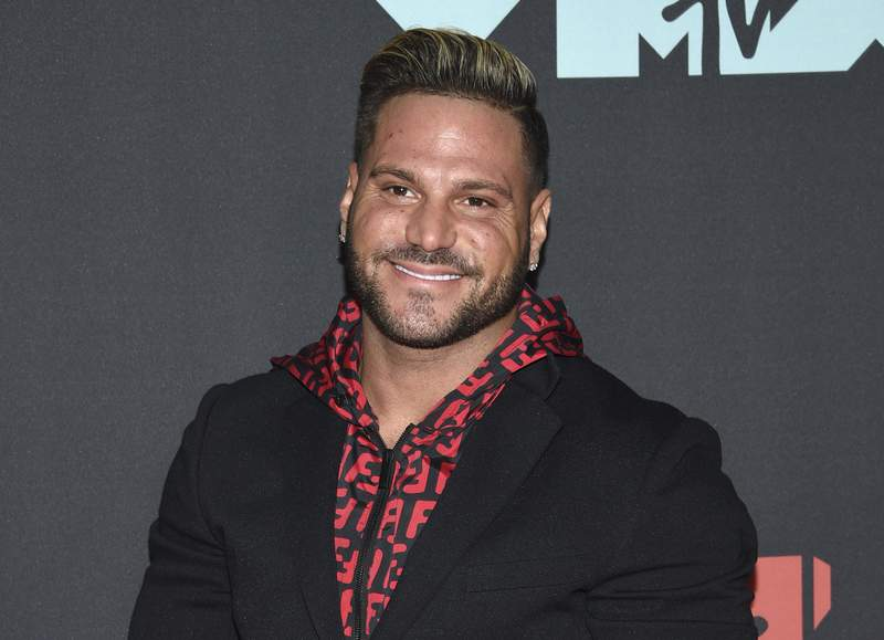 """FILE - This Aug. 26, 2019, file photo shows """"Jersey Shore"""" cast member Ronnie Ortiz-Magro at the MTV Video Music Awards in Newark, N.J. Ortiz-Magro will not be charged after an arrest on suspicion of domestic violence in April 2021, but will charge the 35-year-old with a probation violation based on a domestic violence conviction in a different case in 2020. (Photo by Evan Agostini/Invision/AP, File)"""