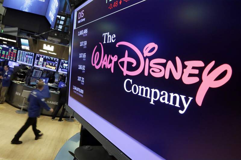 FILE - In this Aug. 8, 2017, file photo, The Walt Disney Co. logo appears on a screen above the floor of the New York Stock Exchange. The Walt Disney Co. has dramatically slashed its advertising budget on Facebook and Facebook-owned Instagram, according to a report in the Wall Street Journal.  (AP Photo/Richard Drew, File)