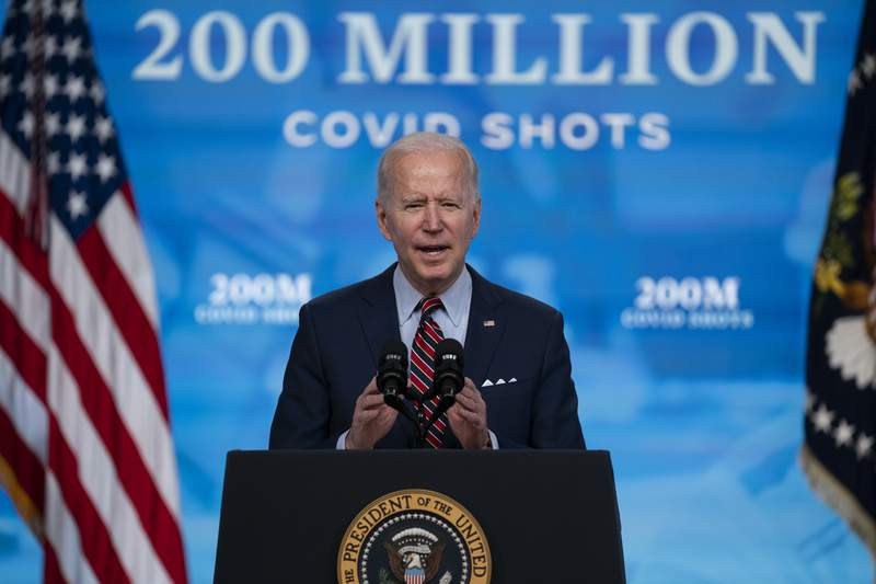FILE - In this April 21, 2021, file photo, President Joe Biden speaks about COVID-19 vaccinations at the White House, in Washington. In April, the Biden administration announced plans to share millions of vaccine doses with the world by the end of June. Five weeks later, nations around the globe are still waiting to learn where the vaccines will go and how they will be distributed.(AP Photo/Evan Vucci, File)