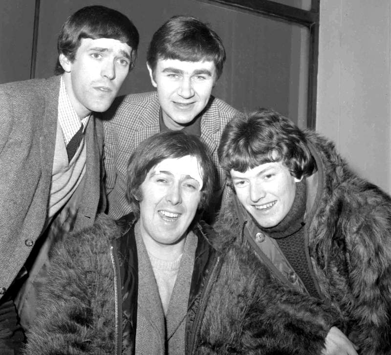 FILE  - In this Jan. 10, 1966 file photo, members of the band, the Spencer Davis Group, from top left: Muff Winwood, Pete York and Steve Winwood and Spencer Davis, foreground. British guitarist and bandleader Spencer Davis, whose eponymous rock group had 1960s hits including Gimme Some Lovin and Im a Man, has died at the age of 81. Davis agent, Bob Birk, said Tuesday, Oct. 20, 2020 that he died in a hospital while being treated for pneumonia.  (AP Photo, File)