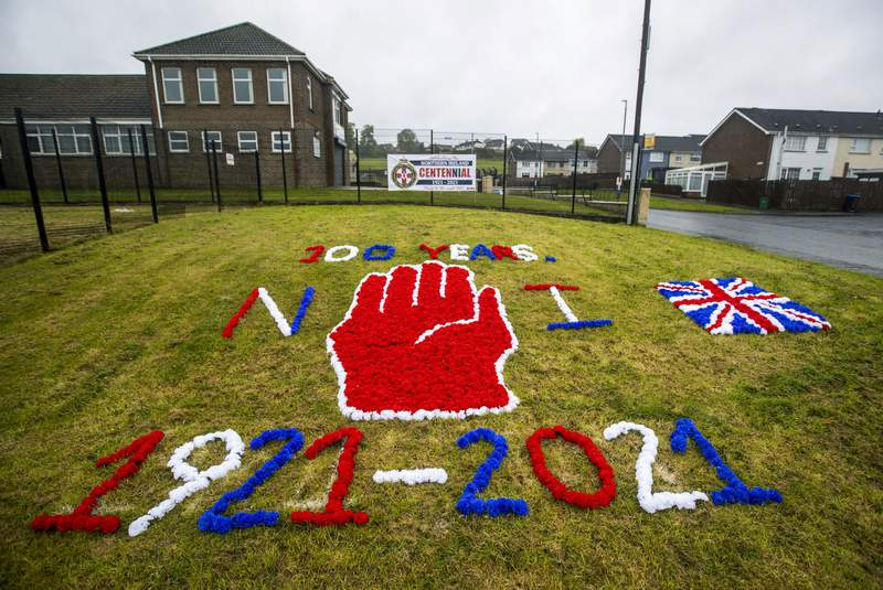 A display on grass celebrating the 100 year centenary of Northern Ireland, in Ballyduff, Newtonabbey, Northern Ireland, Monday, May 3, 2021. Queen Elizabeth II has stressed the need for reconciliation, equality and mutual understanding as she sent her warmest best wishes to the people of Northern Ireland to mark what is widely considered to be its centenary. Northern Ireland was created on May 3, 1921, when the Government of Ireland Act came into effect and partitioned the island of Ireland into two separate entities. Northern Ireland became part of the U.K. alongside England, Scotland and Wales. (Liam McBurney/PA via AP)