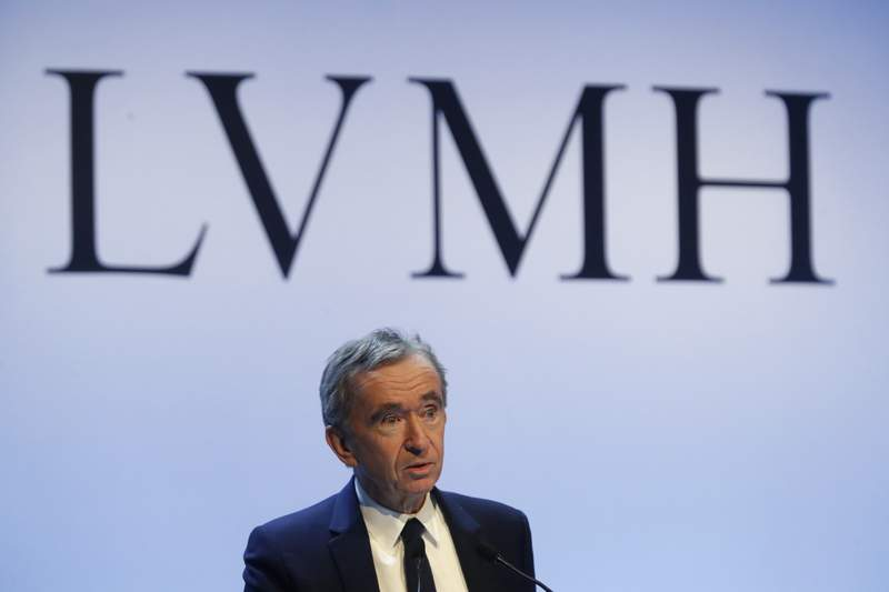 FILE - In this Jan. 28, 2020 file photo, CEO of LVMH Bernard Arnault presents the group's 2019 results during a press conference, in Paris. Arnault and Tods founder Diego Dalle Valle are further cementing their 20-year friendship with a deal for the French group to increase its stake in the Italian luxury goods maker. Shares in the Italian luxury fashion group Tods jumped by more than 10%, to 39.02 euros, Friday on news of the 75-million-euro deal. (AP Photo/Thibault Camus, File)