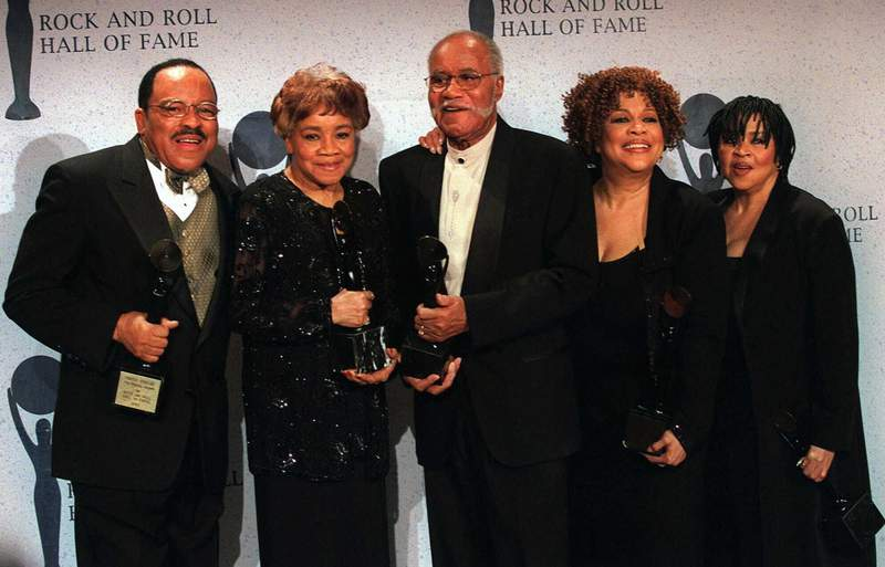 FILE - In tis March 15, 1999 file photo, The Staple Singers, from left, Pervis, Cleotha, Pops, Mavis, and Yvonne pose at the Rock and Roll Hall of Fame induction ceremony in New York. Pervis Staples, whose tenor voice complimented his fathers and sisters in The Staple Singers, died Thursday, May 6, 2021, at his home in Dalton, Ill., a spokesman for sister Mavis Staples, said Wednesday, May 12 , 2021. He was 85.  (AP Photo/Albert Ferreira, File)