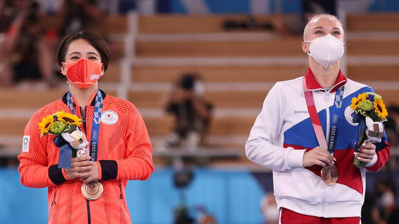 Mai Murakami of Team Japan and Angelina Melnikova of Team ROC look on during the Women's Floor Exercise Final on day ten of the Tokyo 2020 Olympic Games