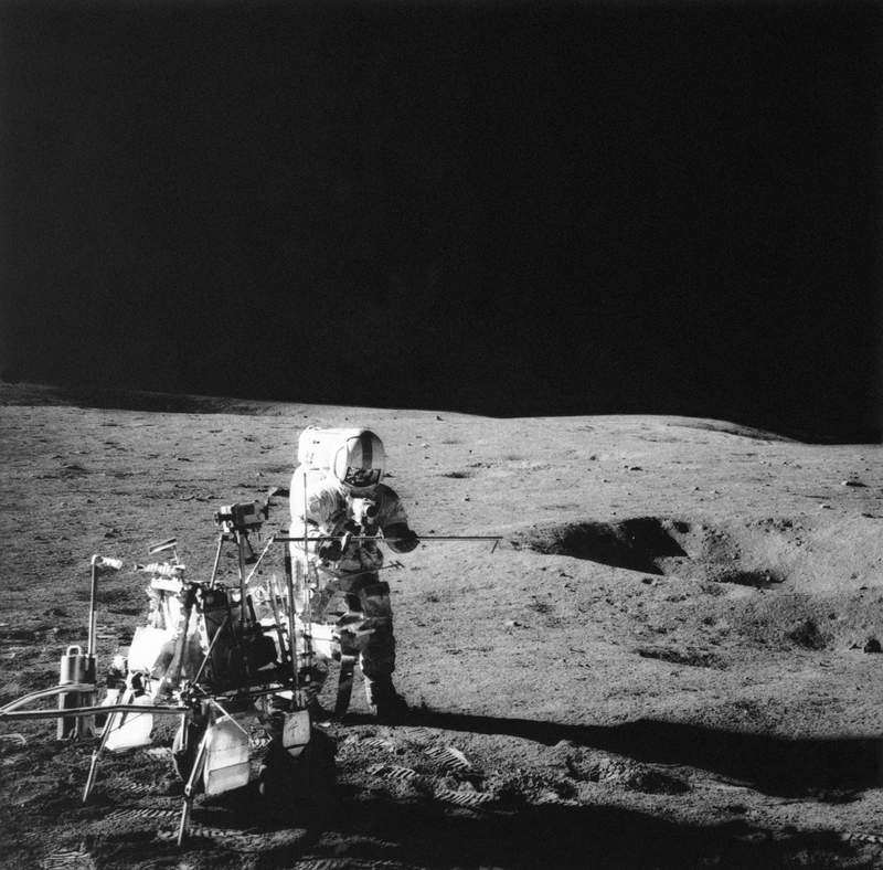 FILE - In this Feb. 6, 1971, file photo, Apollo 14 astronaut Alan B. Shepard Jr. conducts an experiment near a lunar crater using an instrument from a two-wheeled cart carrying various test tools. Apollo 14 commander Alan B. Shepard Jr. and his crew brought back 42 kilograms of moon rocks. Left behind were two golf balls that Shepard, who later described the moon's surface as one big sand trap, hit with a makeshift 6-iron to become a footnote in history. (NASA via AP, File)
