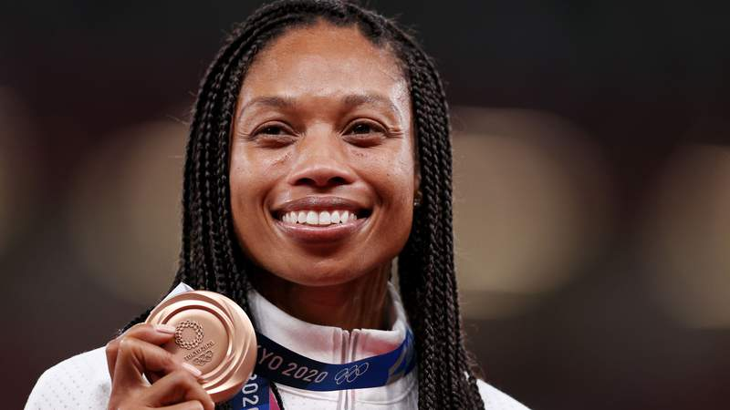 TOKYO, JAPAN - AUGUST 06: Bronze medalist Allyson Felix of Team USA holds her medal on the podium during the medal ceremony for the Women's 400m on day fourteen of the Tokyo 2020 Olympic Games at Olympic Stadium on August 06, 2021 in Tokyo, Japan. (Photo by Christian Petersen/Getty Images)