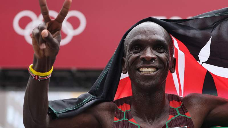 Kenya's Eliud Kipchoge celebrates after winning the men's marathon final during the Tokyo 2020 Olympic Games in Sapporo on August 8, 2021. (Photo by Giuseppe CACACE / AFP) (Photo by GIUSEPPE CACACE/AFP via Getty Images)