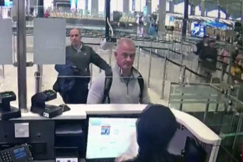 FILEThis Dec. 30, 2019 image from security camera video shows Michael L. Taylor, center, and George-Antoine Zayek at passport control at Istanbul Airport in Turkey. Taylor is accused of smuggling former Nissan Motor Co. Chairman Carlos Ghosn out of Japan in 2019 while he was awaiting trial on financial misconduct charges. (DHA via AP, File)