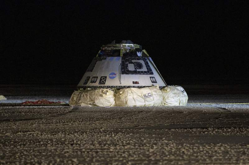 FILE - This Sunday, Dec. 22, 2019 file photo shows the Boeing Starliner spacecraft after it landed in White Sands, N.M. On Friday, Feb. 28, 2020, Boeing acknowledged it failed to conduct full and adequate software tests before the botched space debut of its astronaut capsule late last year. (Bill Ingalls/NASA via AP)