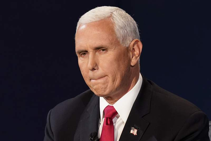 FILE - Vice President Mike Pence listens during the vice presidential debate Wednesday, Oct. 7, 2020, at Kingsbury Hall on the campus of the University of Utah in Salt Lake City. Health policy specialists are questioning Pences claim that federal rules on essential workers allow him to continue to campaign and not quarantine himself after exposure to multiple close staffers with COVID-19. (AP Photo/Patrick Semansky, file)