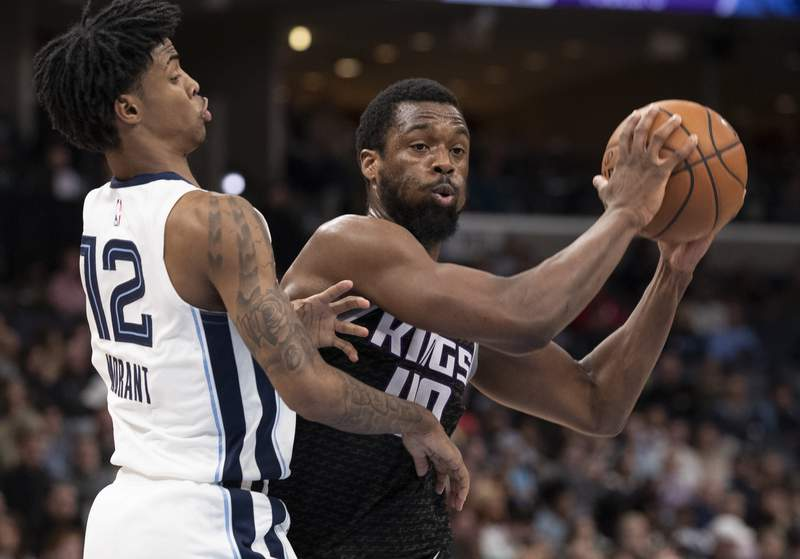 FILE - In this Feb. 28, 2020, file photo, Sacramento Kings forward Harrison Barnes (40) looks to pass while defended by Memphis Grizzlies guard Ja Morant (12) during the first half of an NBA basketball game in Memphis, Tenn. Harrison Barnes became the latest NBA player to reveal that he has coronavirus, making the announcement Tuesday, July 14, 2020, and saying he has hopes to join his team at the leagues restart later this summer. (AP Photo/Nikki Boertman, File)
