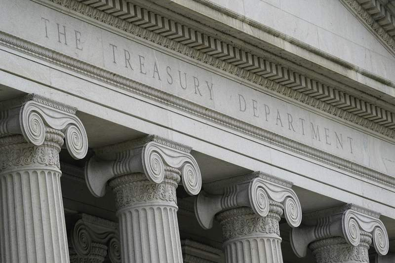 FILE - This May 4, 2021, photo shows the Treasury Building in Washington. The U.S. budget deficit hit a record $2.06 trillion through the first eight months of this budget year as coronavirus relief programs drove spending to all-time highs. The shortfall this year is 9.7% higher than the $1.88 trillion deficit run up over the same period a year ago, the Treasury Department said Wednesday, June 9, 2021 in its monthly budget report. (AP Photo/Patrick Semansky, file)