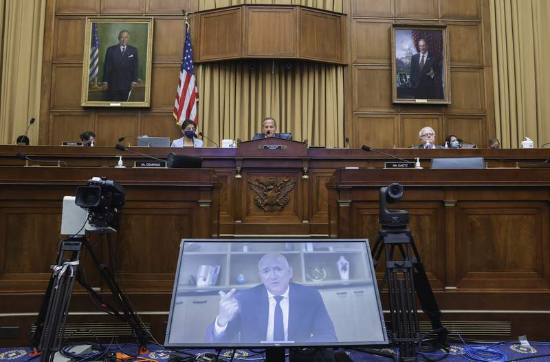 FILE - In this July 29, 2020, file photo, Amazon CEO Jeff Bezos speaks via video conference during a House Judiciary subcommittee hearing on antitrust on Capitol Hill in Washington. After years of calling Big Tech too big, Democratic lawmakers are calling for Congress to rein in Facebook, Google, Amazon and Apple by breaking them up, limiting future mergers and blocking self-dealing that could hurt competitors. Those proposals are in a 450-page report issued Tuesday, Oct. 6, by a House antitrust panel. With the election less than a month away and a new Congress due to be sworn in Jan. 3, there's little chance of action on the report's recommendations this year. (Graeme Jennings/Pool via AP, File)