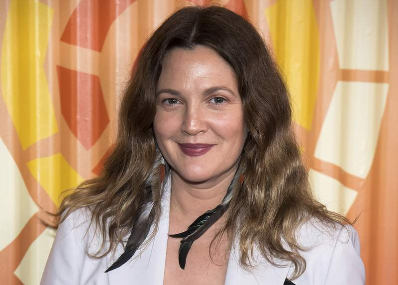 """FILE - Drew Barrymore attends The Charlize Theron Africa Outreach Project fundraiser on Nov. 12, 2019, in New York. Barrymore's first show on Monday, Sept. 13, 2020, distributed by the CBS television studio, features former """"Charlie's Angels"""" co-stars Cameron Diaz and Lucy Liu as guests, along with Adam Sandler. Her show, retrofitted for the COVID-19 era, will originate from New York, where she's now living to raise her two daughters. (Photo by Charles Sykes/Invision/AP, file)"""