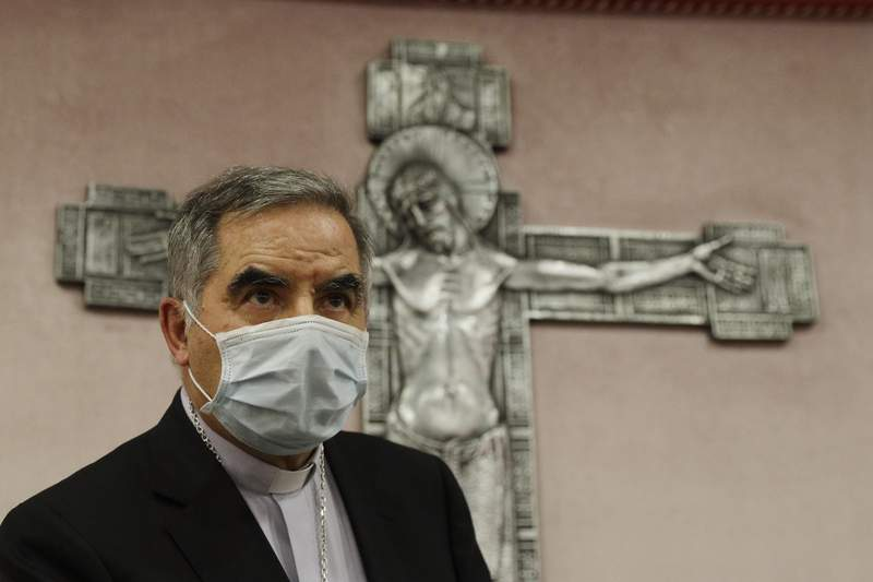 FILE - In this Friday, Sept. 25, 2020 file photo, Cardinal Angelo Becciu talks to journalists during a press conference in Rome. Defense lawyers are questioning the very legitimacy of the Vatican tribunal where 10 people are on trial, including Becciu, on finance-related charges, arguing their clients cant get a fair trial in an absolute monarchy where the pope has already intervened in the case and where prosecutors have failed to turn over key pieces of evidence. (AP Photo/Gregorio Borgia, File)