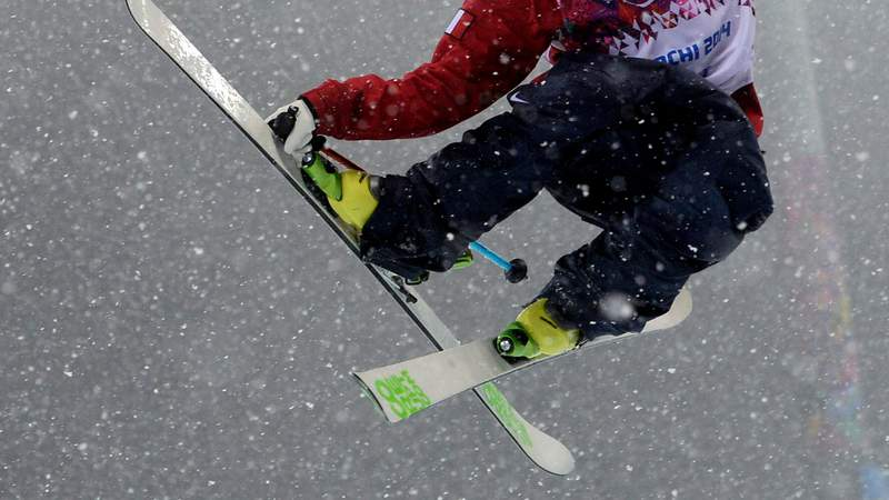 A freestyle skier competes in the Men's Freestyle Skiing Halfpipe finals at the Rosa Khutor Extreme Park during the Sochi Winter Olympics on Feb. 18, 2014.