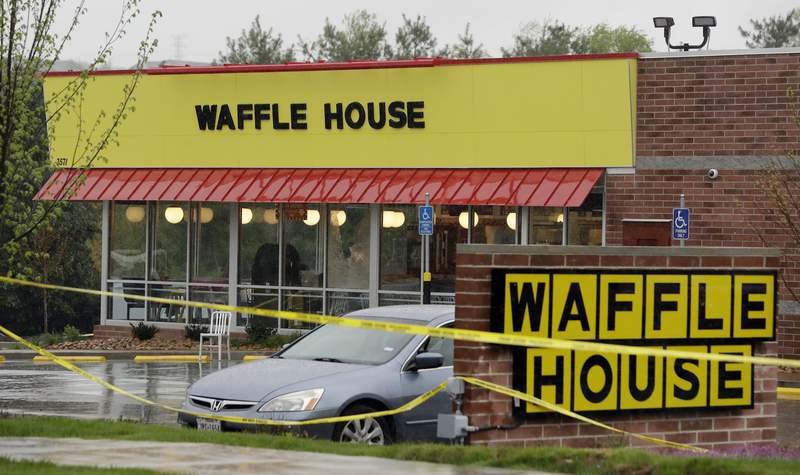FILE - In this April 22, 2018, file photo, police tape blocks off a Waffle House restaurant in Nashville, Tenn., after a gunman opened fire at the restaurant. Attorneys who filed a lawsuit against the Waffle House in Tennessee after a deadly shooting in 2018 will be able to access some of the files that have been sealed in the criminal case against the gunman, a judge ruled Thursday, Oct. 7, 2021. (AP Photo/Mark Humphrey, File)