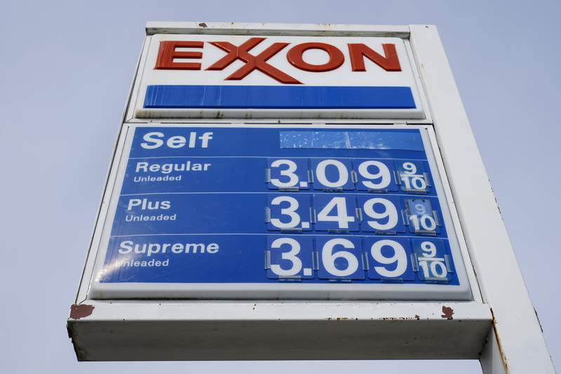 Shown is an Exxon service station sign in Philadelphia, Wednesday, April 28, 2021.  Exxon Mobil reported profits of $2.73 billion in the first quarter, after a tumultuous year led to major spending reductions. The The Irving, Texas company produced 3.8 million barrels of oil per day in the first quarter, up 3% from the fourth quarter of 2020.  (AP Photo/Matt Rourke)