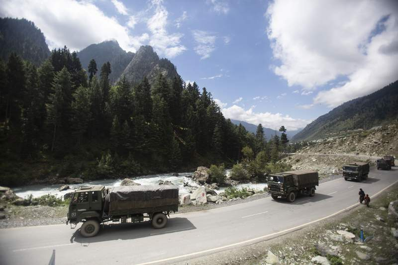 """An Indian army convoy moves on the Srinagar- Ladakh highway at Gagangeer, northeast of Srinagar, Indian-controlled Kashmir, Tuesday, Sept. 1, 2020. India said Monday its soldiers thwarted provocative movements by Chinas military near a disputed border in the Ladakh region months into the rival nations deadliest standoff in decades. China's military said it was taking necessary actions in response,"""" without giving details. (AP Photo/Mukhtar Khan)"""