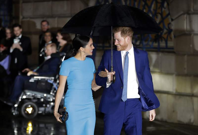 FILE - In this Thursday, March 5, 2020, file photo, Britain's Prince Harry and Meghan arrive at the annual Endeavour Fund Awards in London. The Duke and Duchess of Sussex's foundation has helped support the completion of an emergency relief center in the Commonwealth. World Central Kitchen announced Wednesday, Feb. 24, 2021, that the construction of the first community relief center in Dominica has been completed. (AP Photo/Kirsty Wigglesworth, File)