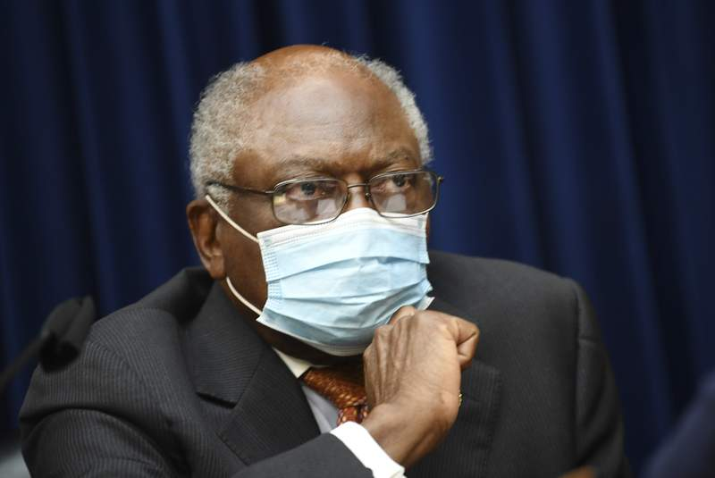 FILE - In this Sept. 23, 2020 file photo, Committee Chairman Rep. Jim Clyburn, D-S.C., during a House Select Subcommittee on the Coronavirus Crisis hearing on Capitol Hill in Washington. Trump administration political appointees tried to block or change more than a dozen government reports that detailed scientific findings about the spread of the coronavirus, according to a House panel investigating the alleged interference. (Kevin Dietsch/Pool via AP)
