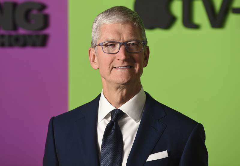 """FILE - In this Oct. 28, 2019 file photo, Apple CEO Tim Cook attends the world premiere of Apple's """"The Morning Show"""" at David Geffen Hall in New York. Cook will take the witness stand this Friday, May 20, 2021 in a high-stakes courtroom battle challenging the lucrative commissions that the iPhone maker has been raking in from a mobile app store that has become a cornerstone of its $2 trillion empire. (Photo by Evan Agostini/Invision/AP, File)"""