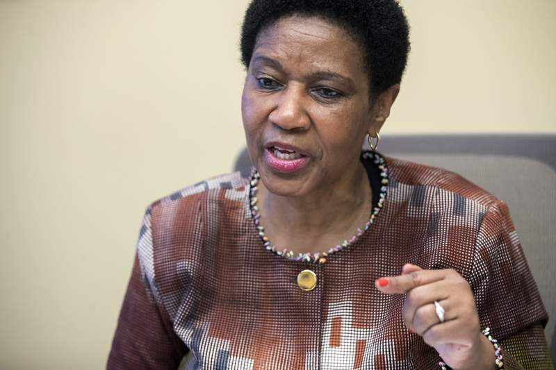 """FILE - In this Wednesday, March 7, 2018 file photo, Phumzile Mlambo-Ngcuka, United Nations Under-Secretary-General and Executive Director of U.N. Women, speaks during an interview with The Associated Press, in New York. The U.N. health agency and its partners have found in a new study released Tuesday, March 9, 2021 that nearly one in three women worldwide have experienced physical or sexual violence in their lifetimes, calling the results a horrifying picture that requires action by government and communities alike. Phumzile Mlambo-Ngcuka, executive director of UN Women, called violence against women """"the most widespread and persistent human rights violation that is not prosecuted. (AP Photo/Mary Altaffer, file)"""