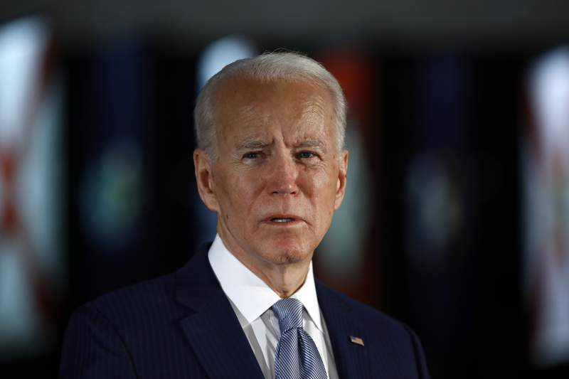FILE - In this March 10, 2020, file photo, Democratic presidential candidate former Vice President Joe Biden speaks to members of the press at the National Constitution Center in Philadelphia. The police killing of George Floyd and the civil and political unrest thats rocked the nation in the week since has the potential to reshape Joe Bidens vice-presidential selection process.  (AP Photo/Matt Rourke, File)