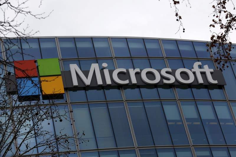 The logo of Microsoft is displayed outside the headquarters in Paris, Friday, Jan. 8, 2021. As the pandemic raged through the U.S., Microsoft's business continued chugging ahead and beat Wall Street expectations for the last three months of 2020, powered by ongoing demand for its workplace software and cloud computing services as people worked from home. The company on Tuesday, Jan. 26, 2021 reported fiscal second-quarter profit of $15.5 billion, up 33% from the same period last year. (AP Photo/Thibault Camus, file)