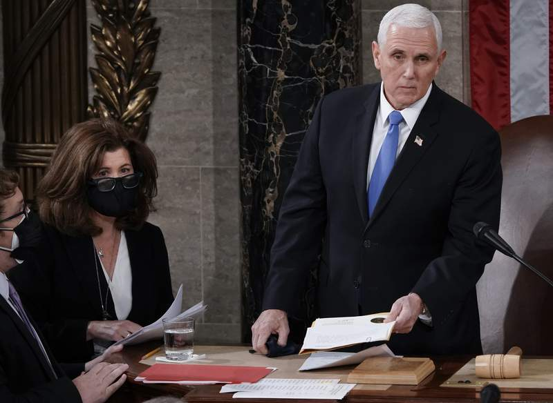 FILE - In this Jan. 6, 2021, file photo, Senate Parliamentarian Elizabeth MacDonough, second from left, works beside Vice President Mike Pence during the certification of Electoral College ballots in the presidential election, in the House chamber at the Capitol in Washington. Shortly afterward, the Capitol was stormed by rioters determined to disrupt the certification. (AP Photo/J. Scott Applewhite, File)