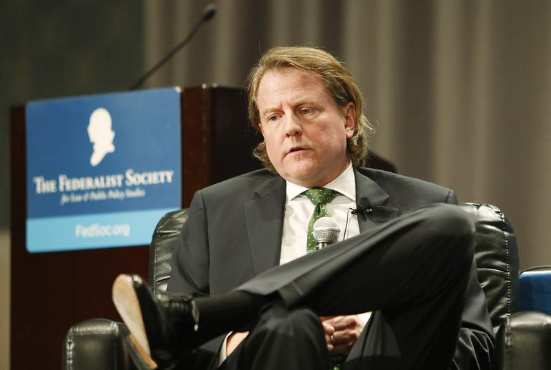 Former White House Counsel Donald F. McGahn talks with Jan Crawford, Chief Legal Correspondent with CBS News during a session at the Federalist Society Sixth Annual Florida Chapters Conference held at Disney's Yacht and Beach Club Resorts in Lake Buena Vista, Florida on Friday, January 31, 2020.(Octavio Jones/Tampa Bay Times via AP)