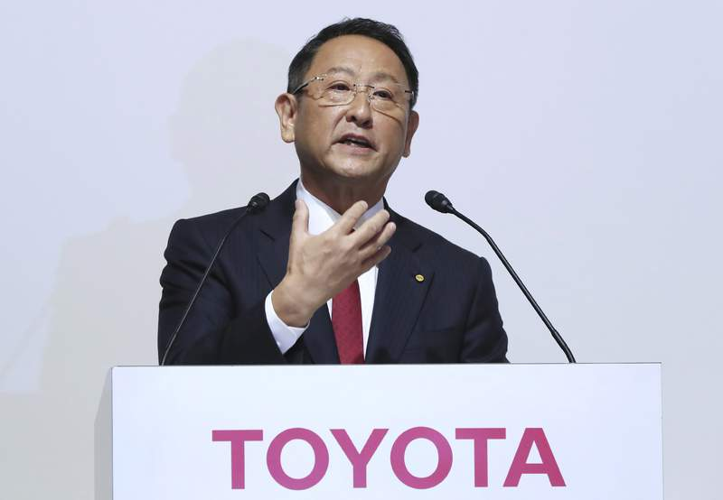 FILE - In this Aug. 4, 2017, file photo, Toyota Motor Corp. President Akio Toyoda answers a question during a joint press conference with Mazda Motor Corp. President Masamichi Kogai in Tokyo. A suicide by a Toyota engineer that was ruled by Japanese authorities as a power harassment case has reached a settlement, the automaker said Monday, June 7, 2021. (AP Photo/Eugene Hoshiko, File)
