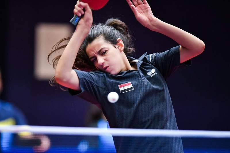 The youngest Tokyo Olympian, 12-year-old Hend Zaza from Syria, was eliminated following her first match.