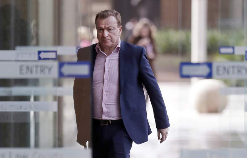 FILE - In this May 6, 2021, file photo, Andrew Cooper, founder and president of libertarian group LibertyWorks, arrives at Federal Court in Sydney. Australias highest court on Wednesday, June 16, 2021 rejected a challenge to foreign interference laws in a case that involved a U.S. conservative political organization and free speech arguments. (AP Photo/Rick Rycroft, File)