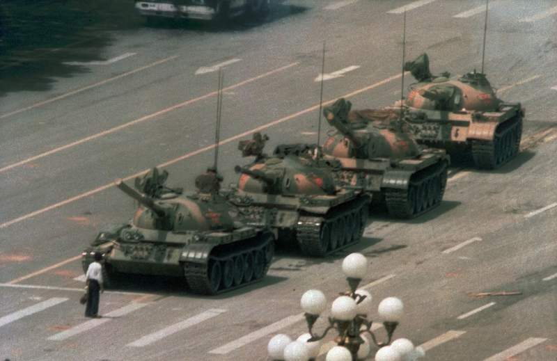 FILE - In this June 5, 1989 file photo, a man stands alone to block a line of tanks heading east on Beijing's Cangan Blvd. in Tiananmen Square.   Microsoft Corp. blamed accidental human error for its Bing search engine briefly not showing image results for the search term tank man on the anniversary of the bloody military crackdown in Beijings Tiananmen Square in 1989. Users in different parts of the world, including the U.S., said Friday, June 4, 2021 that no image results were returned when they searched for the term tank man.  (AP Photo/Jeff Widener, File)