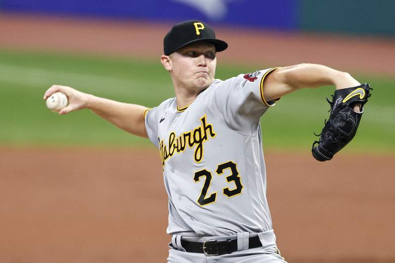 Pittsburgh Pirates starting pitcher Mitch Keller delivers against the Cleveland Indians during the first inning of a baseball game, Friday, Sept. 25, 2020, in Cleveland. (AP Photo/Ron Schwane)