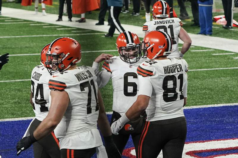 Cleveland Browns quarterback Baker Mayfield (6) celebrates with teammate Austin Hooper (81) after they connect for a touchdown during the first half of an NFL football game against the New York Giants, Sunday, Dec. 20, 2020, in East Rutherford, N.J. (AP Photo/Seth Wenig)