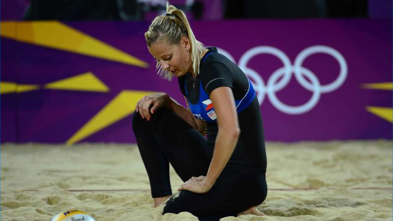 Marketa Slukova (CZE) reacts after missing the ball in the women's beach volleyball quarterfinal match between Slukova (CZE) and Kristyna Kolocova (CZE) against April Ross (USA) and Jennifer Kessy (USA) during the London 2012 Olympic Games.
