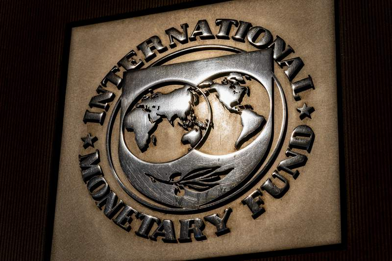 FILE - The logo of the International Monetary Fund is visible on their building, Monday, April 5, 2021, in Washington. Finance officials of the worlds major economies on Wednesday, April 7, 2021 agreed on a proposal to boost the resources of the International Monetary Fund by $650 billion as a way to provide more support to vulnerable countries struggling to deal with a global pandemic. (AP Photo/Andrew Harnik)