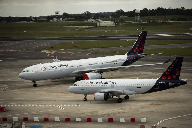 Planes from Brussels Airlines sit idle on the tarmac at Brussels Airport in Brussels, Tuesday, May 12, 2020. Hard-hit by the coronavirus crisis, Brussels Airlines unveiled Tuesday a cost-cutting plan that will result in the reduction of 25 percent of its workforce. The Lufthansa subsidiary, which employs 4,000 people, has suspended its flights as a result of the pandemic, which has put much air travel to a halt. (AP Photo/Francisco Seco)